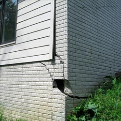 A damaged foundation with wall cracking in Conrad
