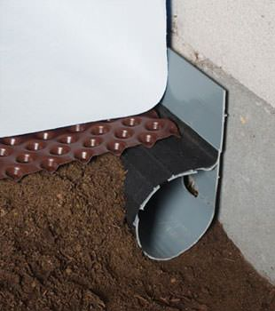 Closeup of a crawl space drainage system installed in Townsend