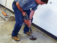 Coring the concrete of a concrete slab floor in Miles City