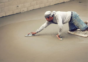 smoothing out the grout in a slab releveling project in Butte