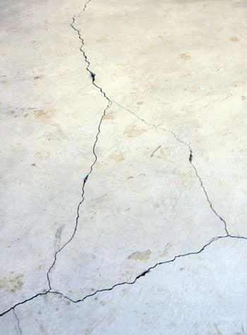 severely cracked, heaving slab floors in a home in Frenchtown
