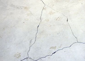 cracks in a slab floor consistent with slab heave in Anaconda.