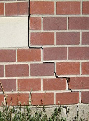photo of a rotating foundation wall with cracks in Shepherd