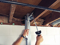 Straightening a foundation wall with the PowerBrace™ i-beam system in a Livingston home.