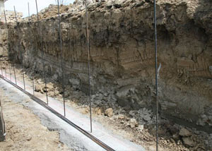 Soil layers exposed while excavating to construct a new foundation in Cody