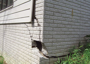 A severely damaged foundation wall in Laurel