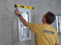 Positioning a wall plate cover on a foundation wall in Butte.