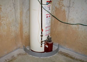 A water heater in Ennis that's been protected by the FloodRing® and a perimeter drain system.
