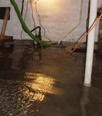 Several feet of floodwaters in a Conrad basement