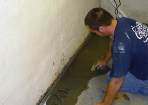 Restoring a concrete slab floor with fresh concrete after jackhammering it and installing a drain system in Cascade.
