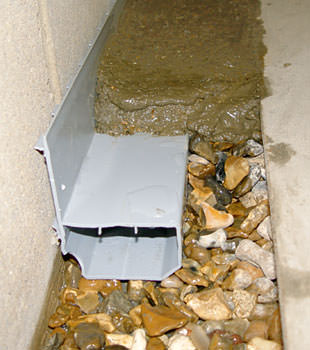 A basement drain system installed in a Butte home