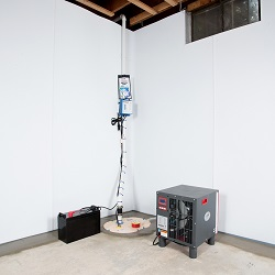 Sump pump system, dehumidifier, and basement wall panels installed during a sump pump installation in Columbus